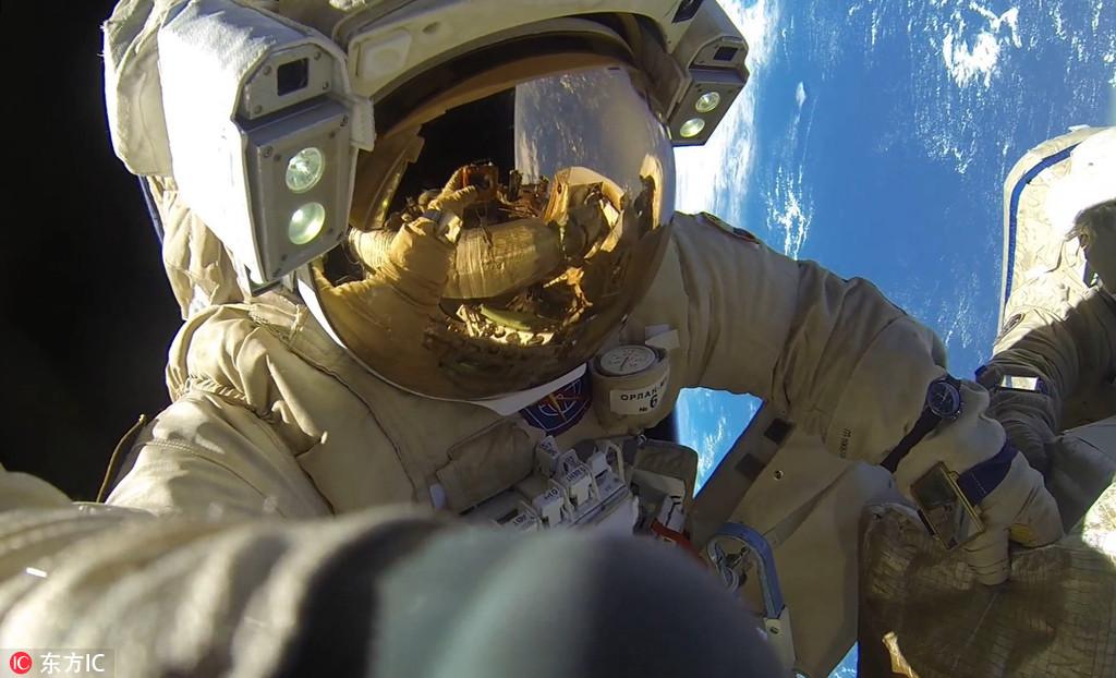 九龙图库8小时12分!俄两名宇航员打破最长太空行走纪录